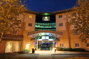 Holiday inn express m27jct7 1 exterior at night
