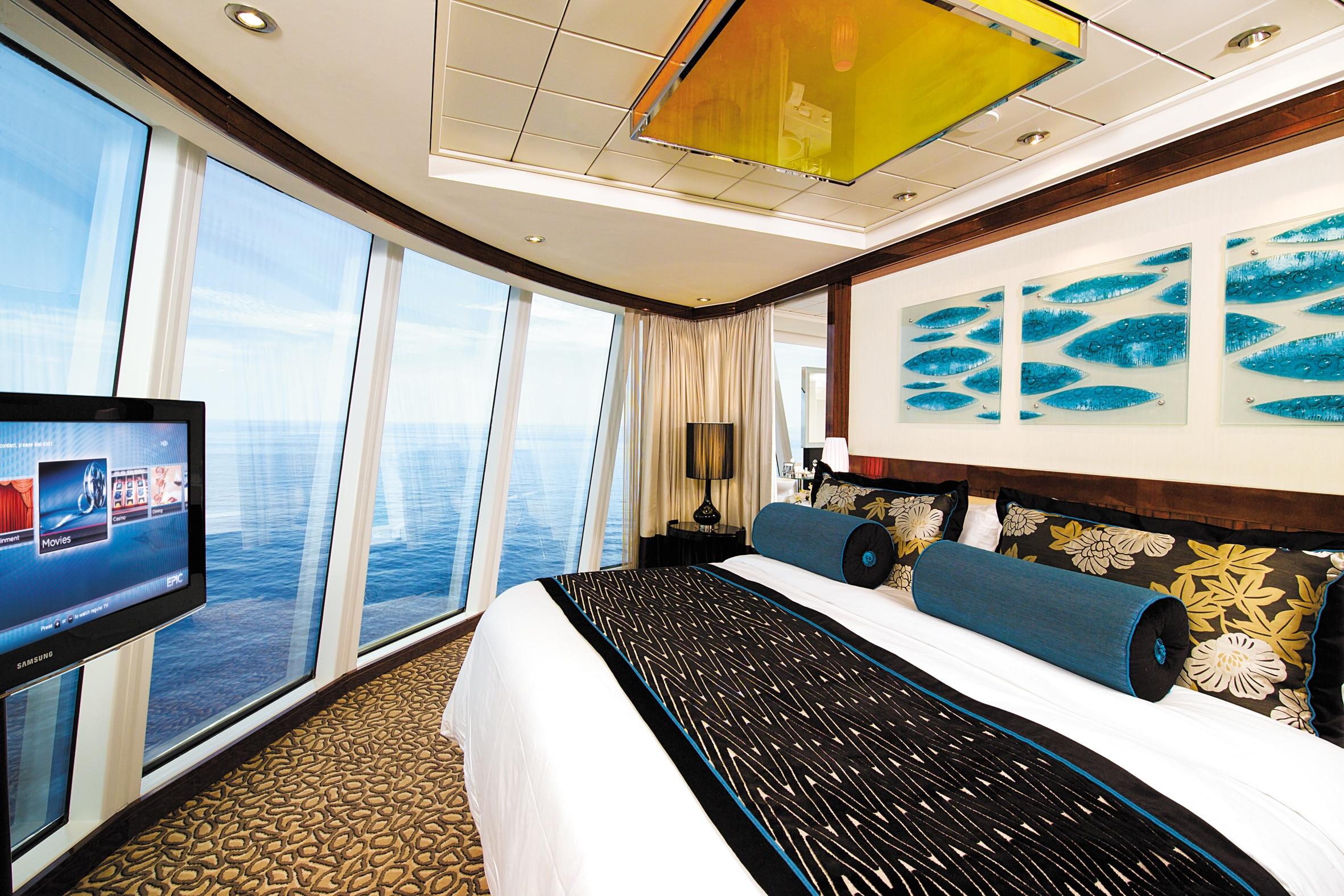 Norwegian Cruise Line Norwegian Epic Accommodation Deluxe Owners Suite Bedroom.jpg