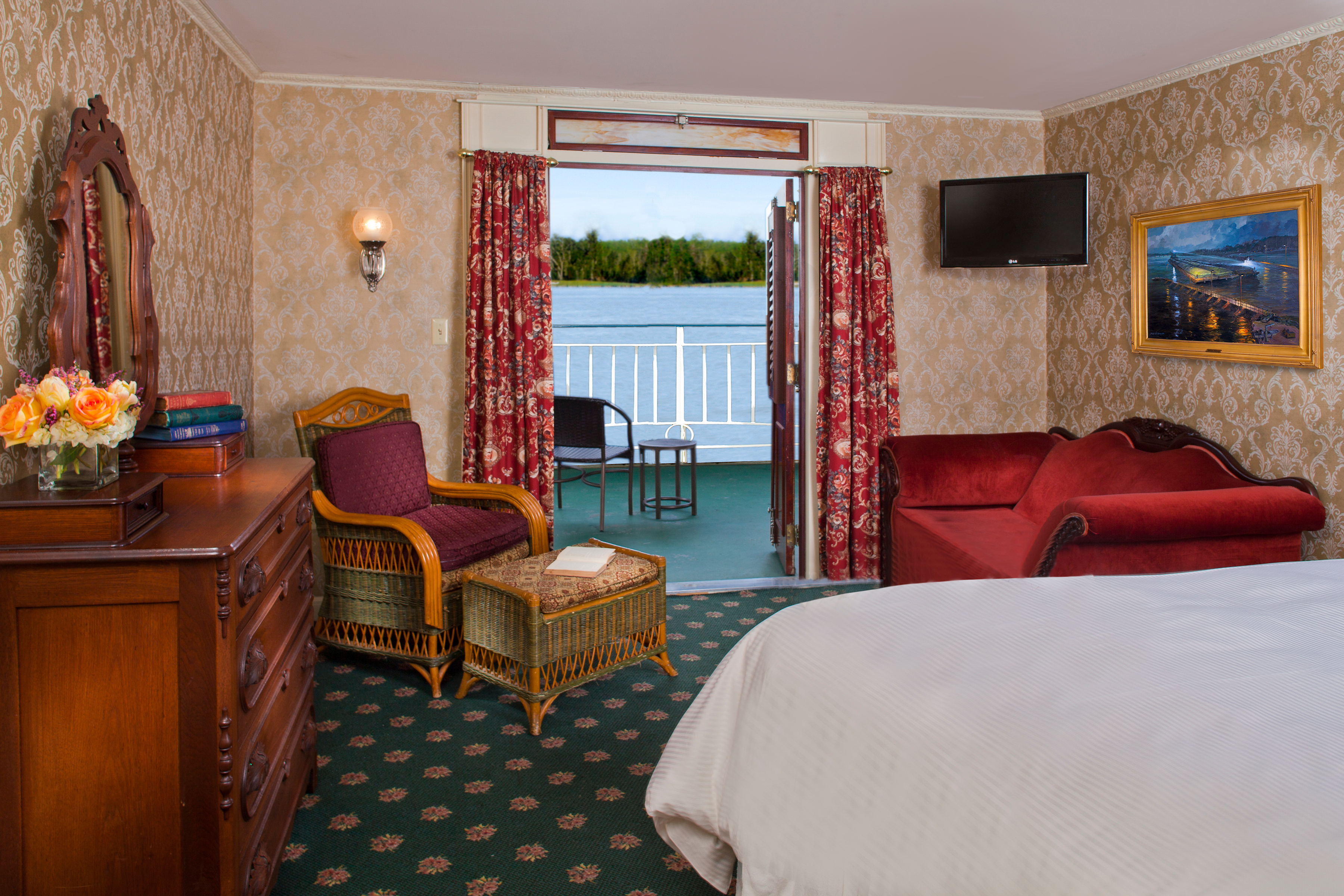American Queen Steamboat Company American Queen Accommodation Deluxe Outside Stateroom with Veranda.jpg