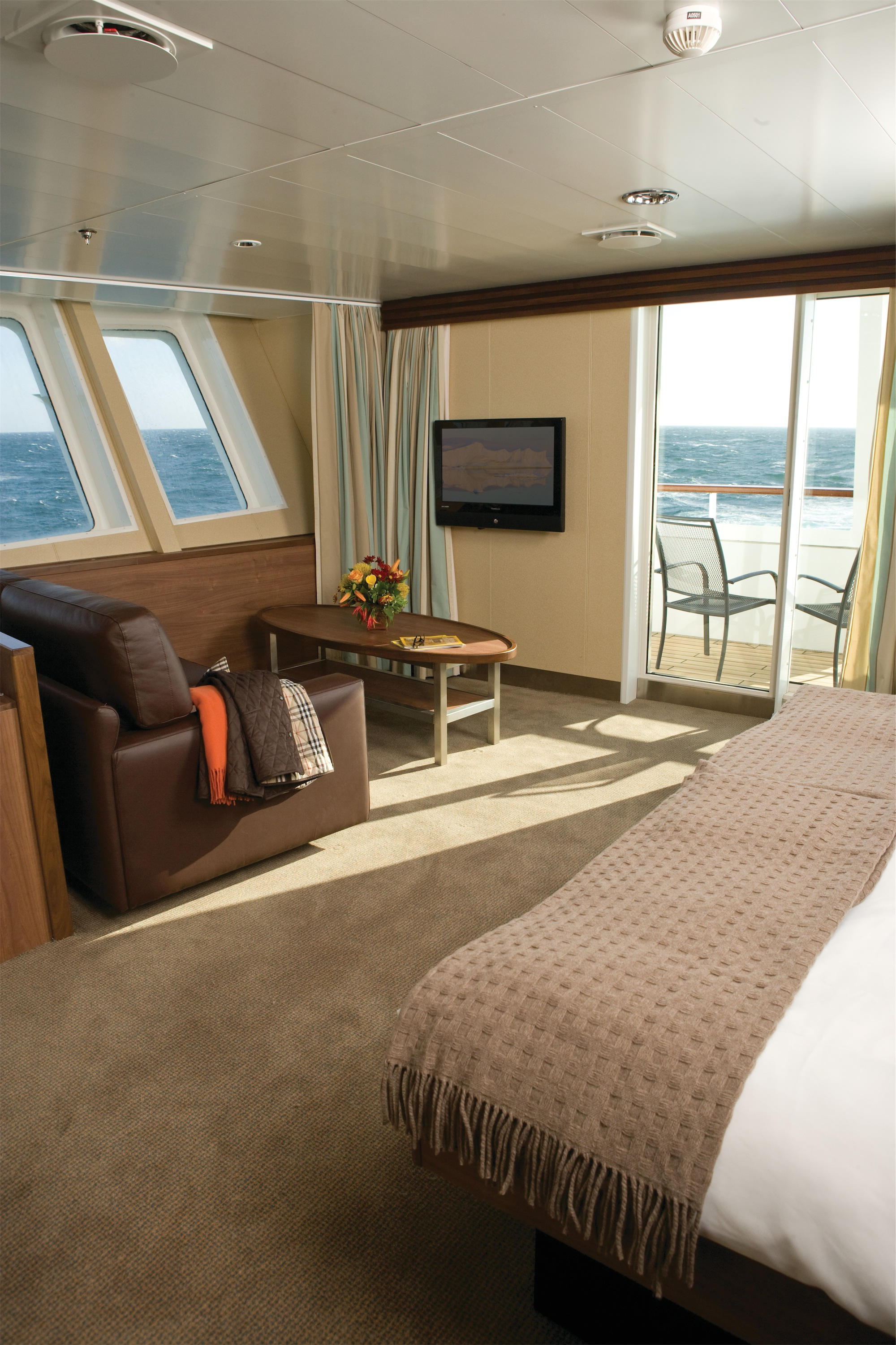 Lindblad Expeditions National Geographic Explorer Accommodation Category 7 Suite with Balcony.jpg