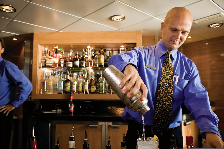 Lindblad Expeditions National Geographic Explorer Interior Bar Bartender.jpg