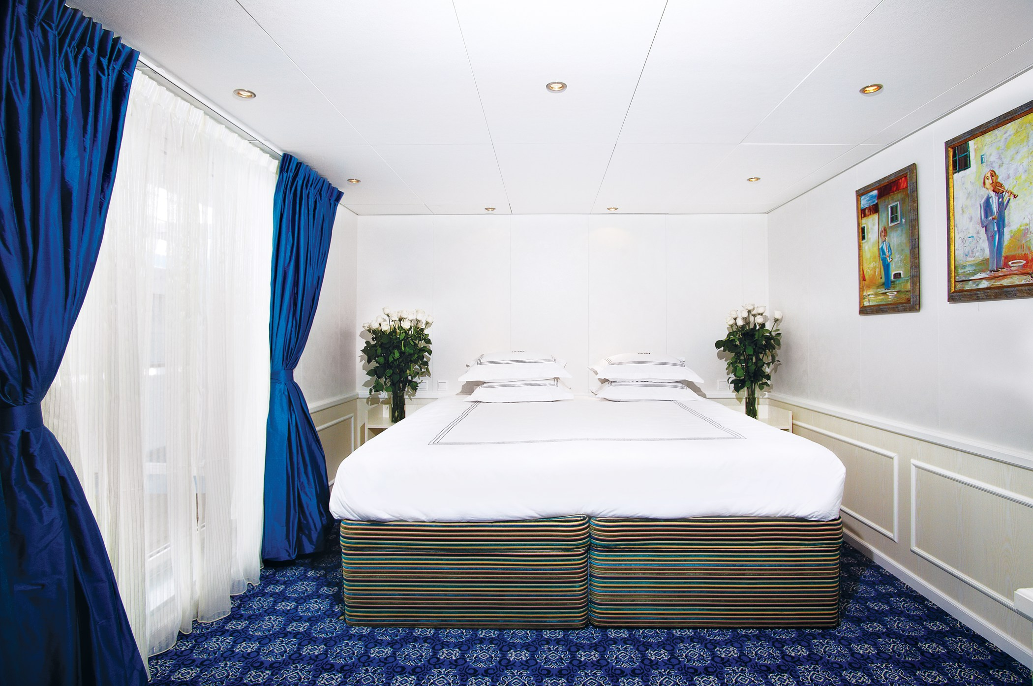 UNIWORLD Boutique River Cruises River Victoria Accommodation Presidential Suite Bedroom.jpg