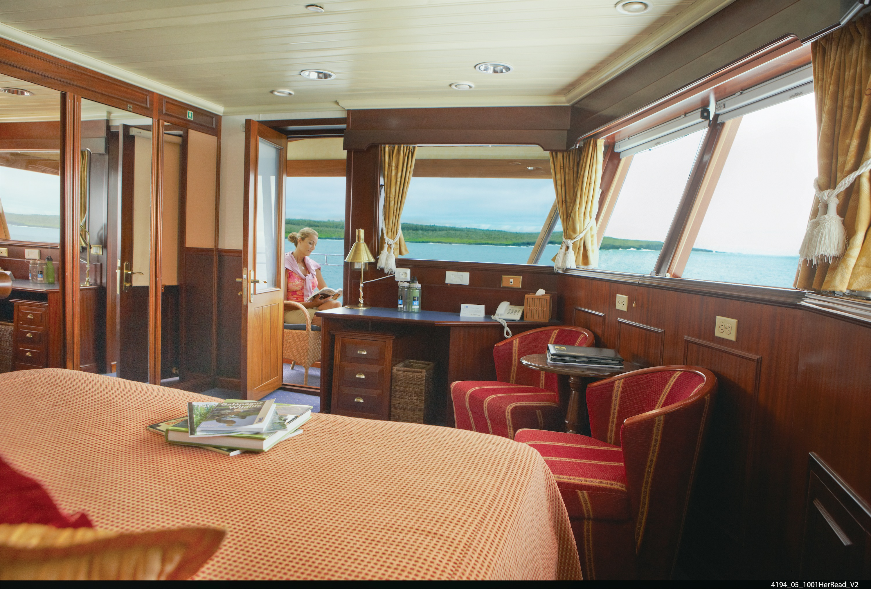 Lindblad Expeditions National Geographic Islander Accommodation Category 5 Living Area & Balcony.jpg
