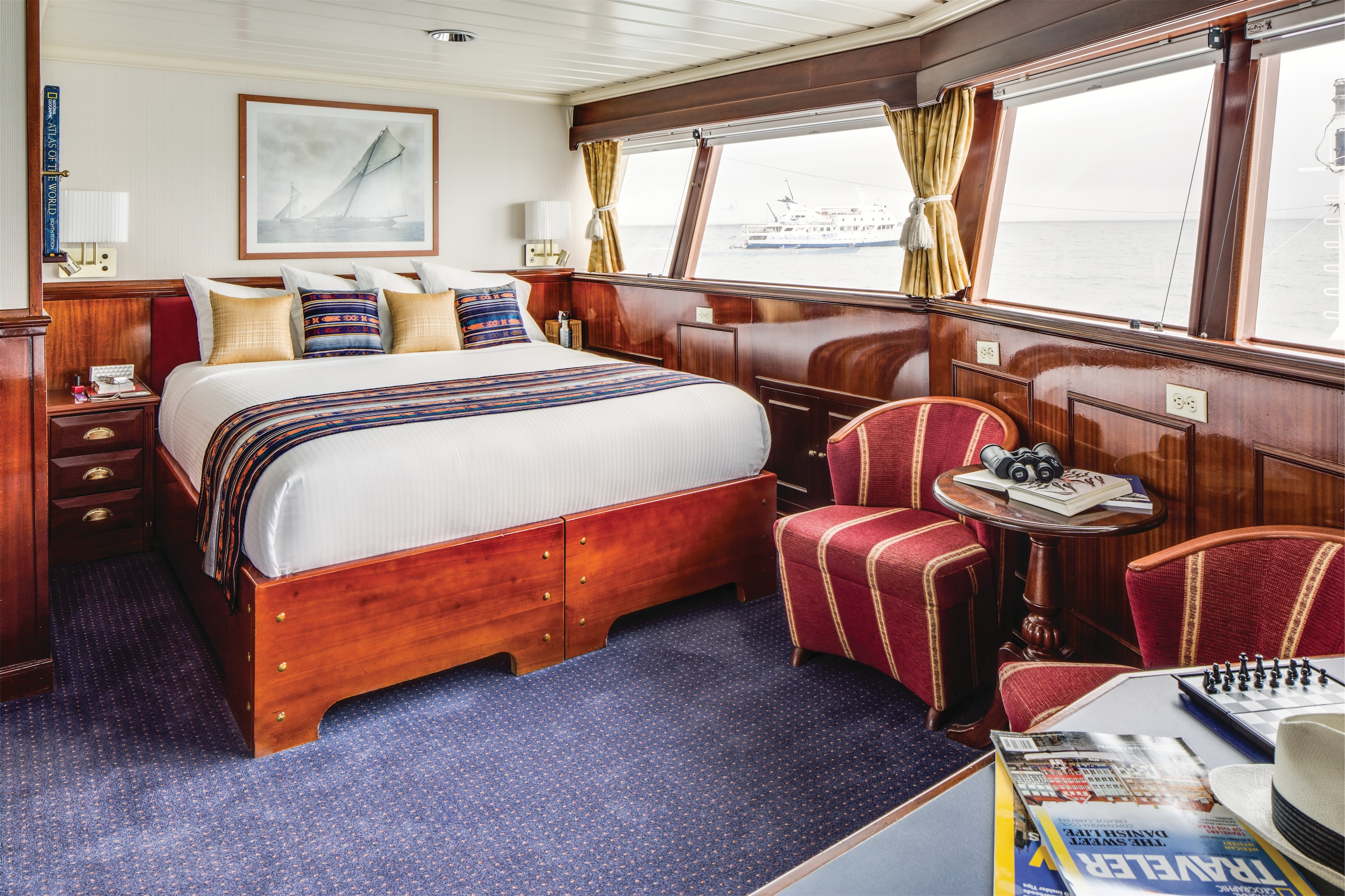 Lindblad Expeditions National Geographic Islander Accommodation Category 5 Bed & Living Room.jpg