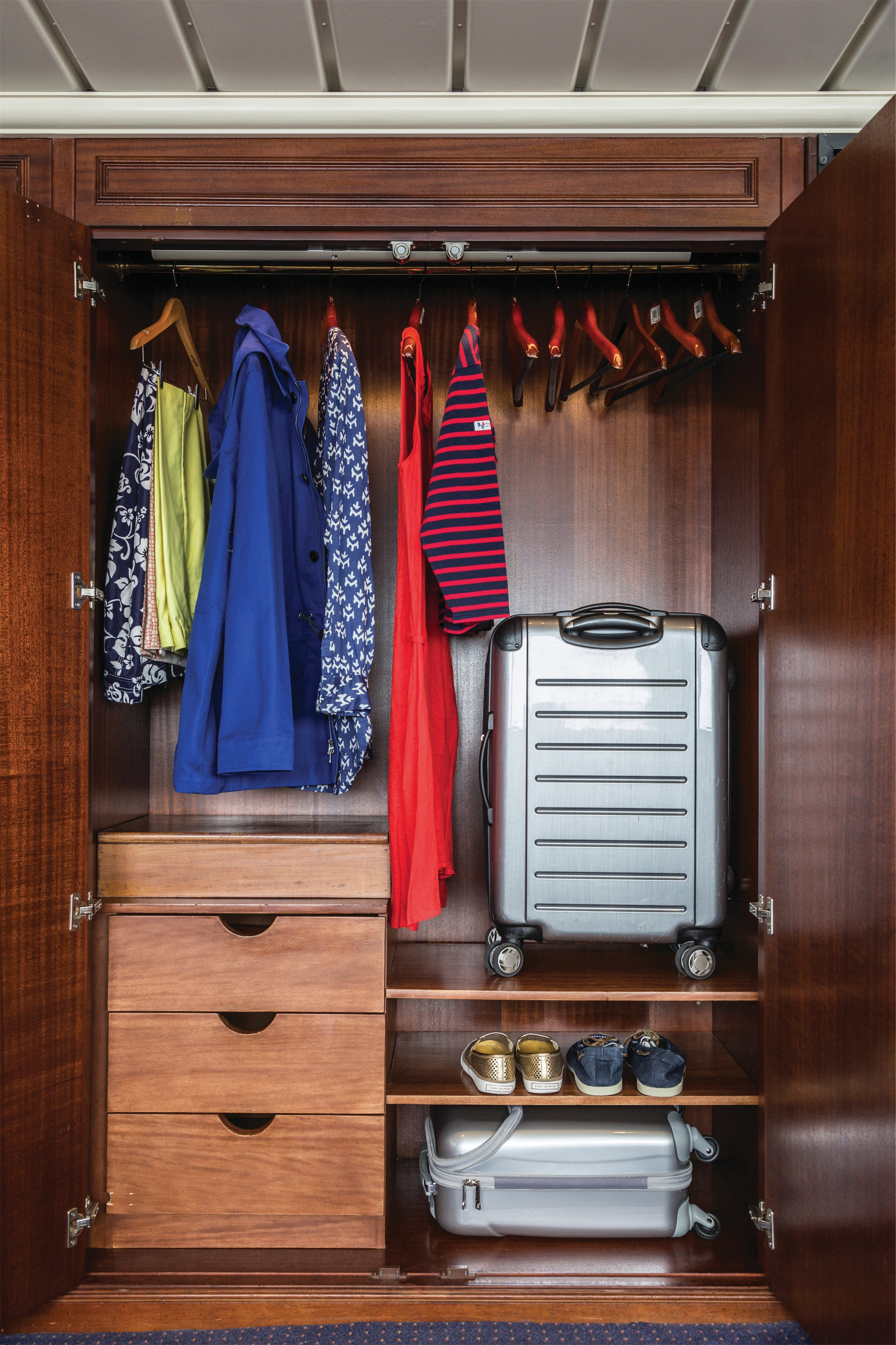 Lindblad Expeditions National Geographic Islander Accommodation Category 5 Closet.jpg
