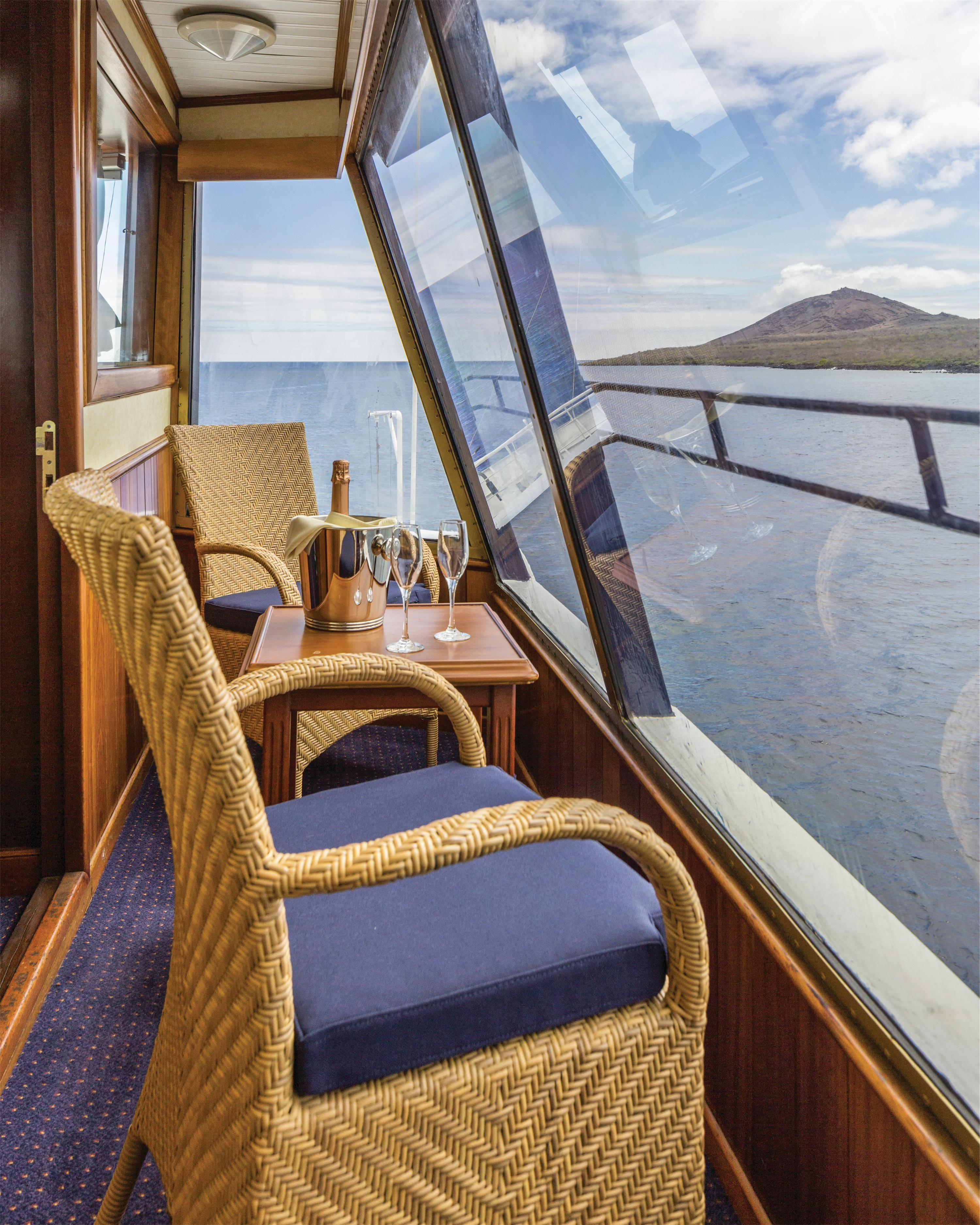 Lindblad Expeditions National Geographic Islander Accommodation Category 5 Balcony.jpg