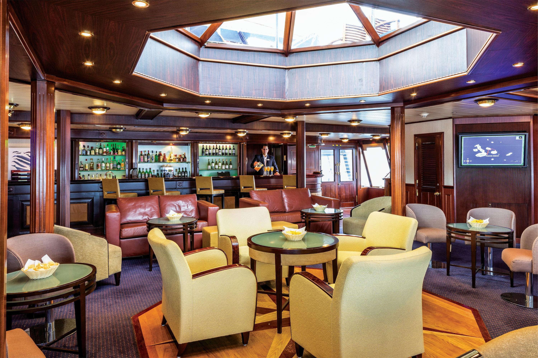 Lindblad Expeditions National Geographic Islander Interior Lounge & Bar.jpg