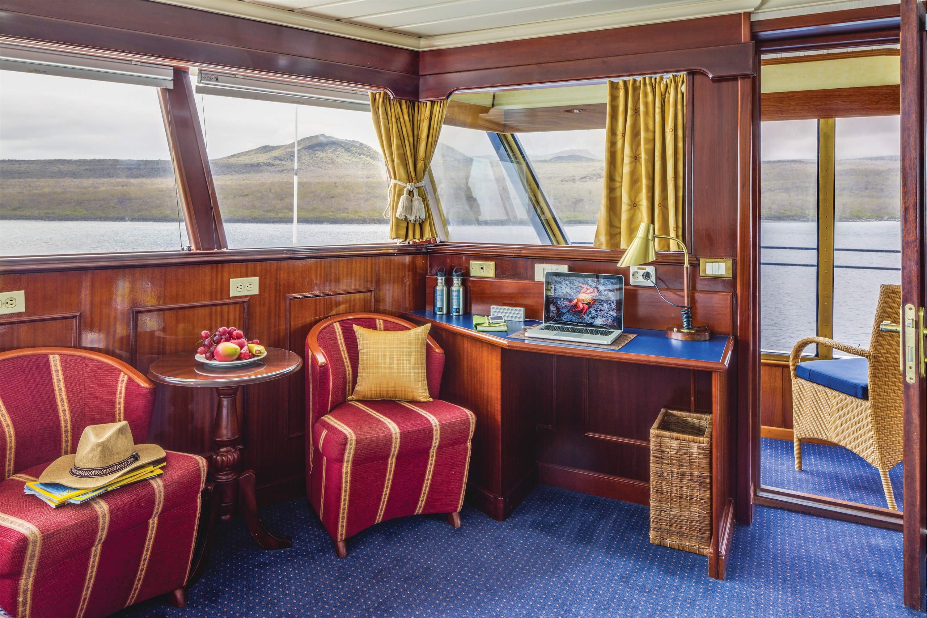 Lindblad Expeditions National Geographic Islander Accommodation Category 5 Living Room & Desk.jpg