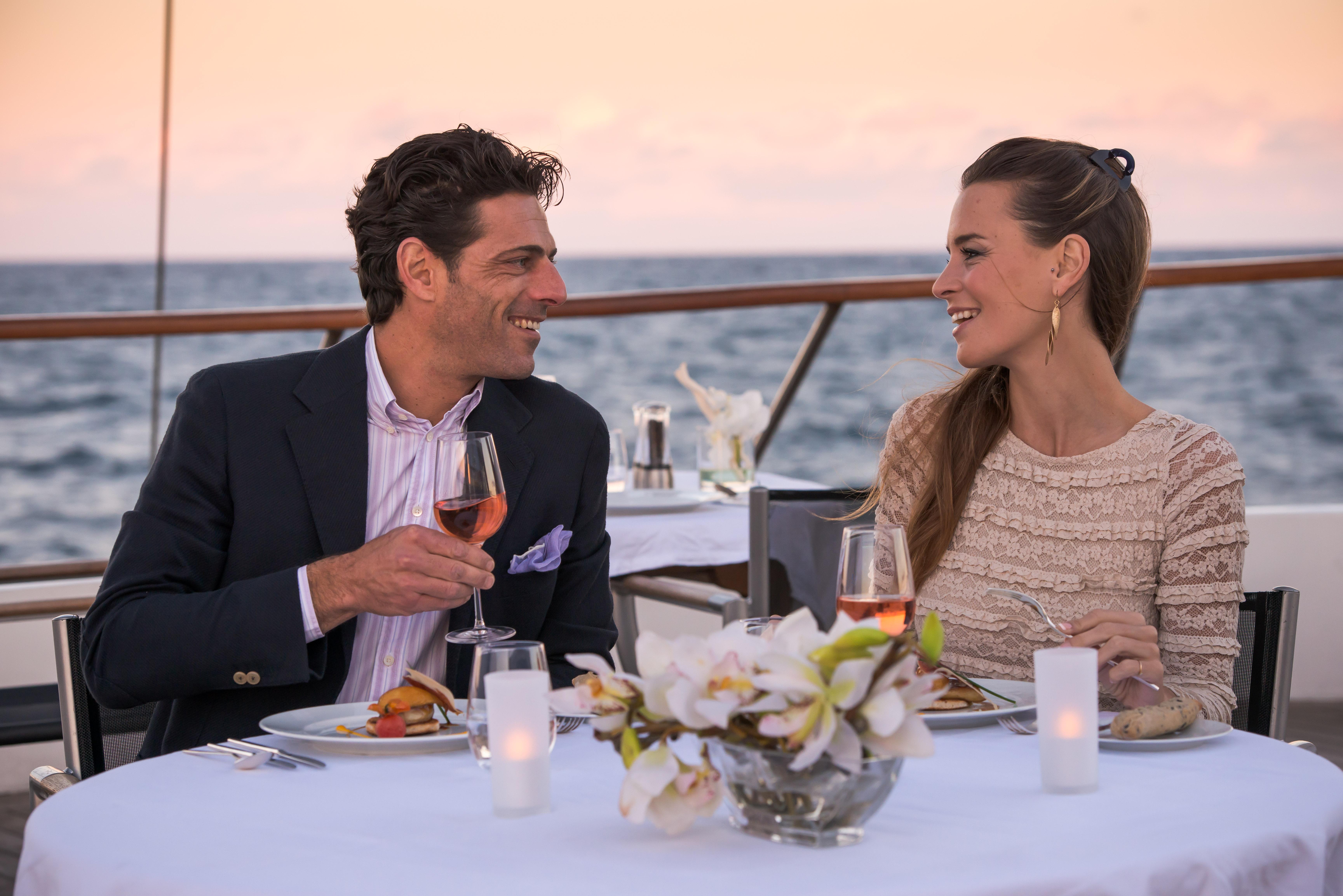 Ponant Le Ponant Exterior Couple Dining on Deck 1.JPEG