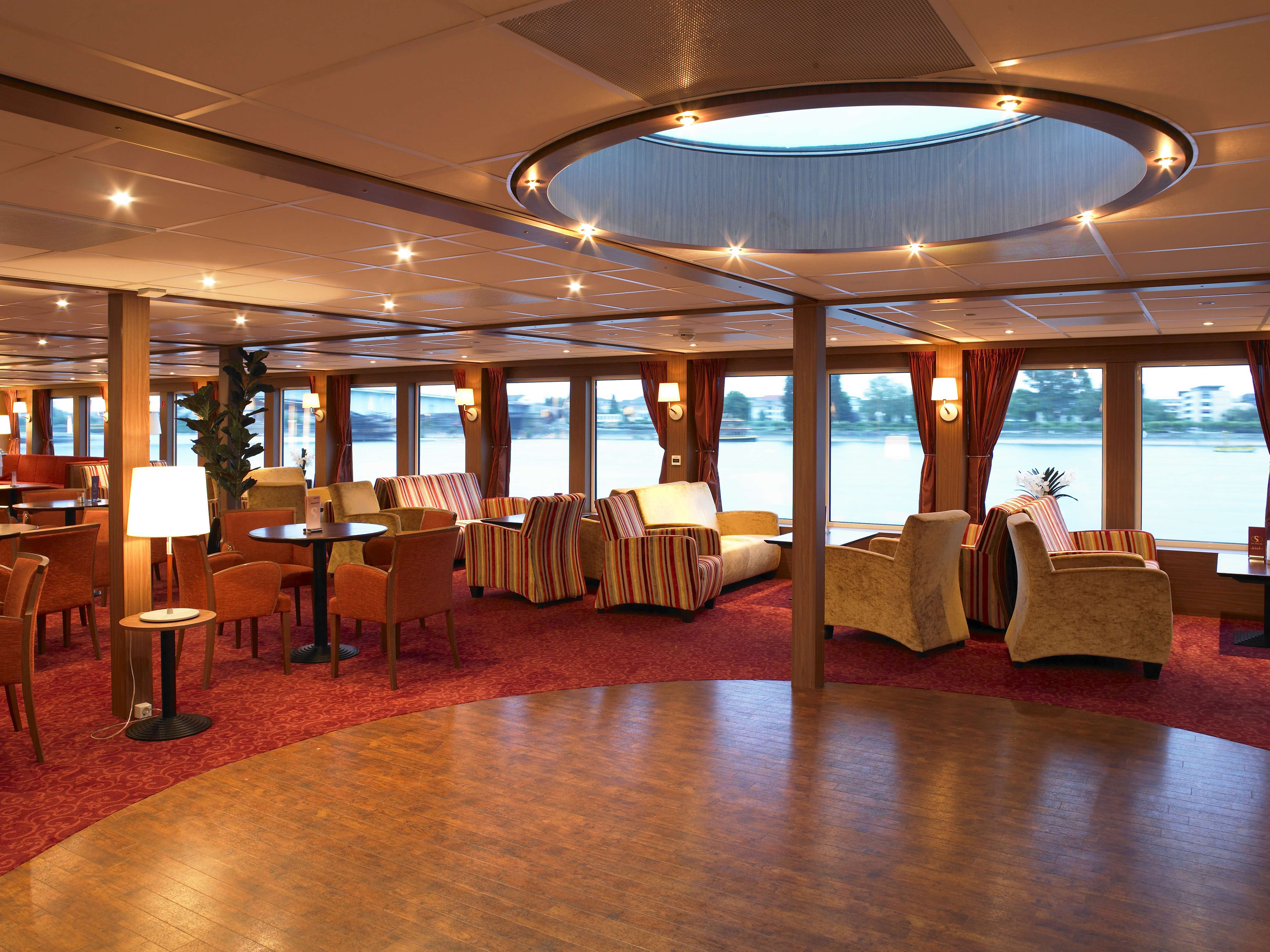The River Cruise Line MS Serenity Interior Lounge 1.jpg