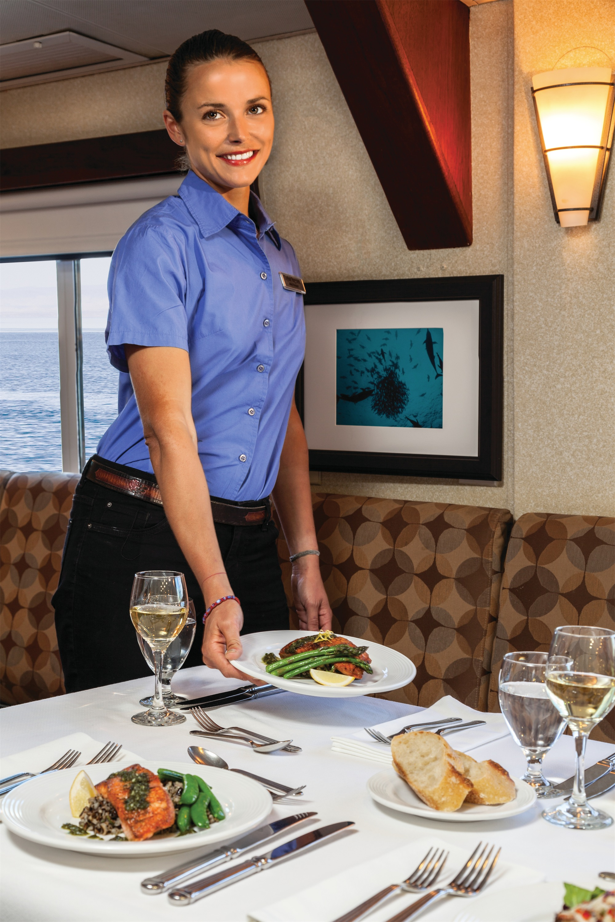 Lindblad Expeditions National Geographic Sea Bird & National Geographic Sea Lion Interior Hotel Manager in Dining Room.jpg