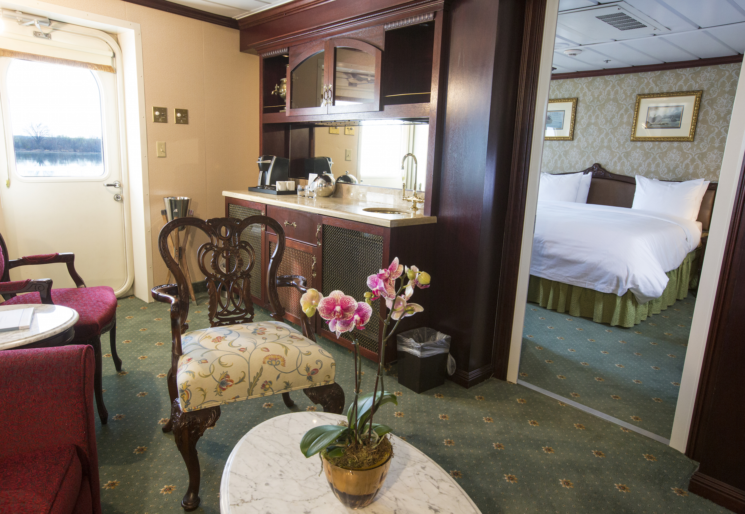 American Queen Steamboat Company American Empress Accommodation Luxury Suite with Veranda.jpg