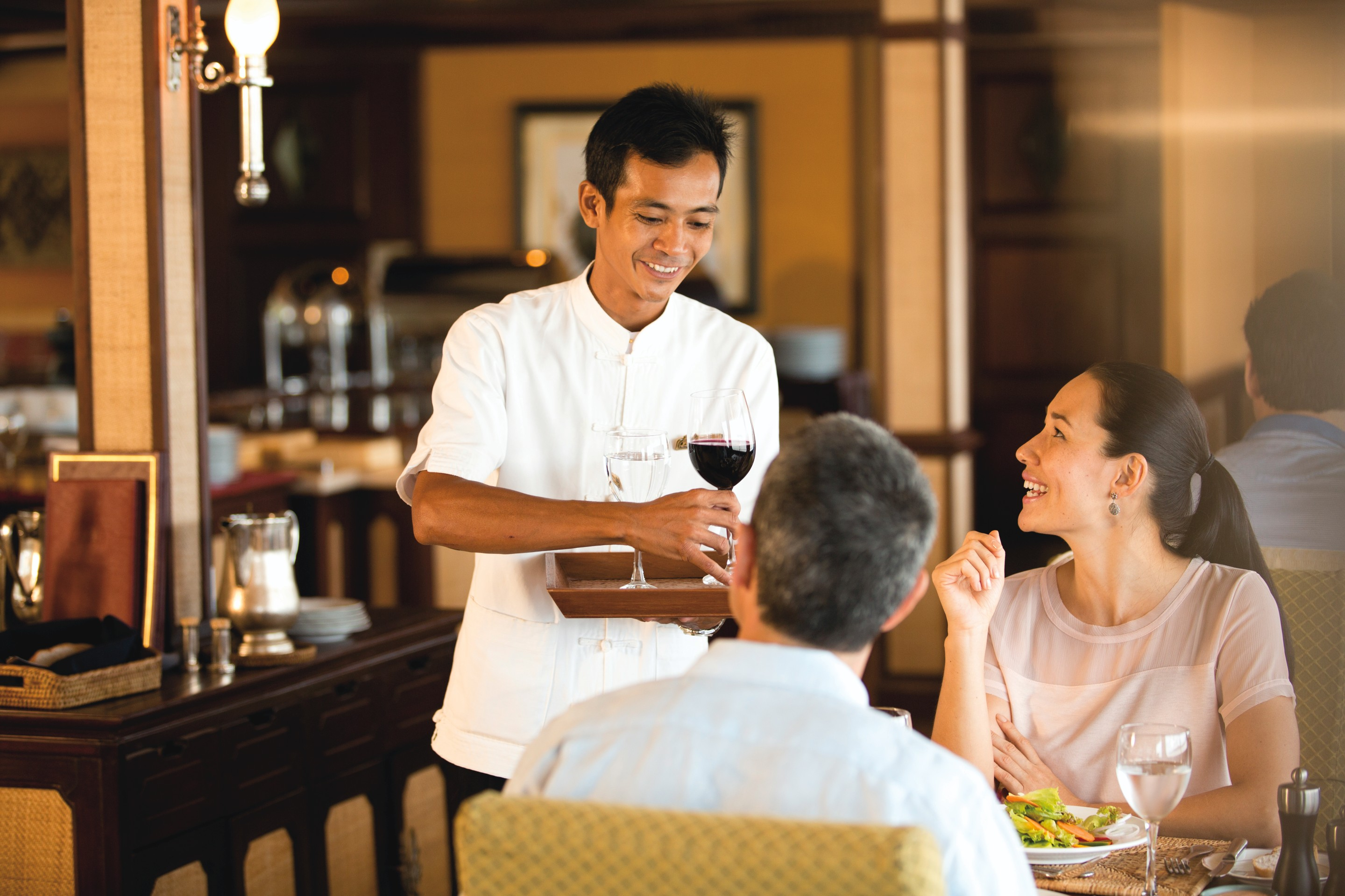 Belmond River Cruises Road to Mandalay Interior Restaurant Staff.jpg