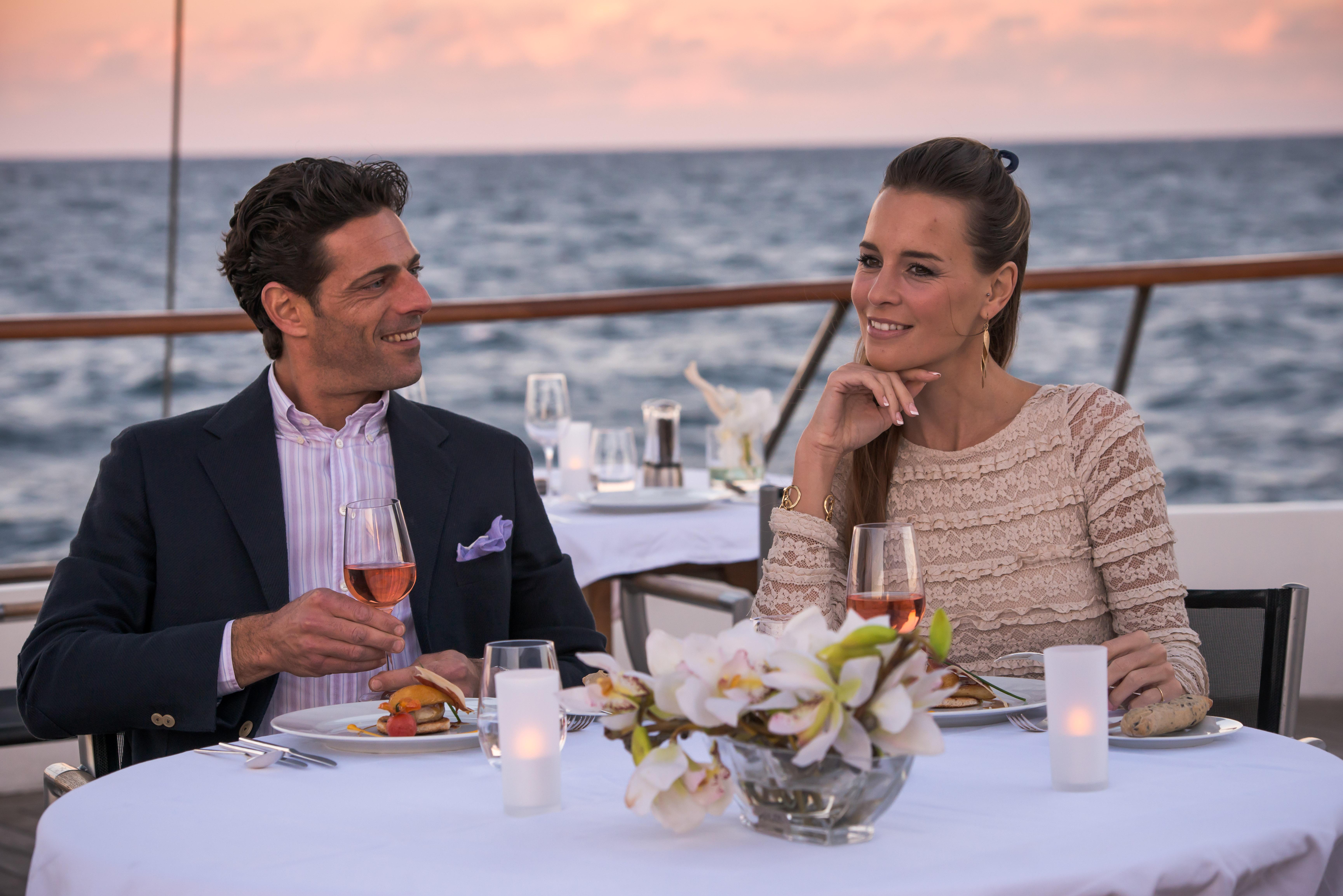 Ponant Le Ponant Exterior Couple Dining on Deck 2.JPEG