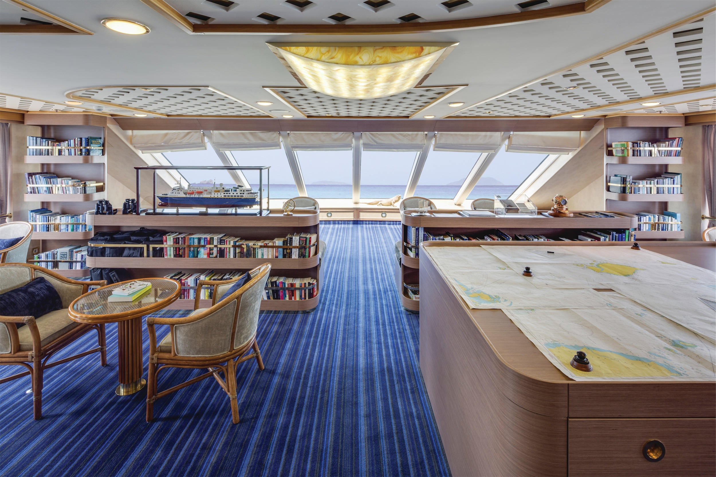 Lindblad Expeditions National Geographic Orion Interior Observation Lounge & Library.jpg