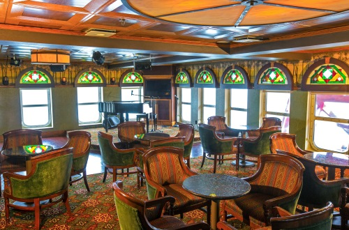 American Queen Steamboat Company American Empress Interior Paddlewheel Lounge Table and Stage.jpg