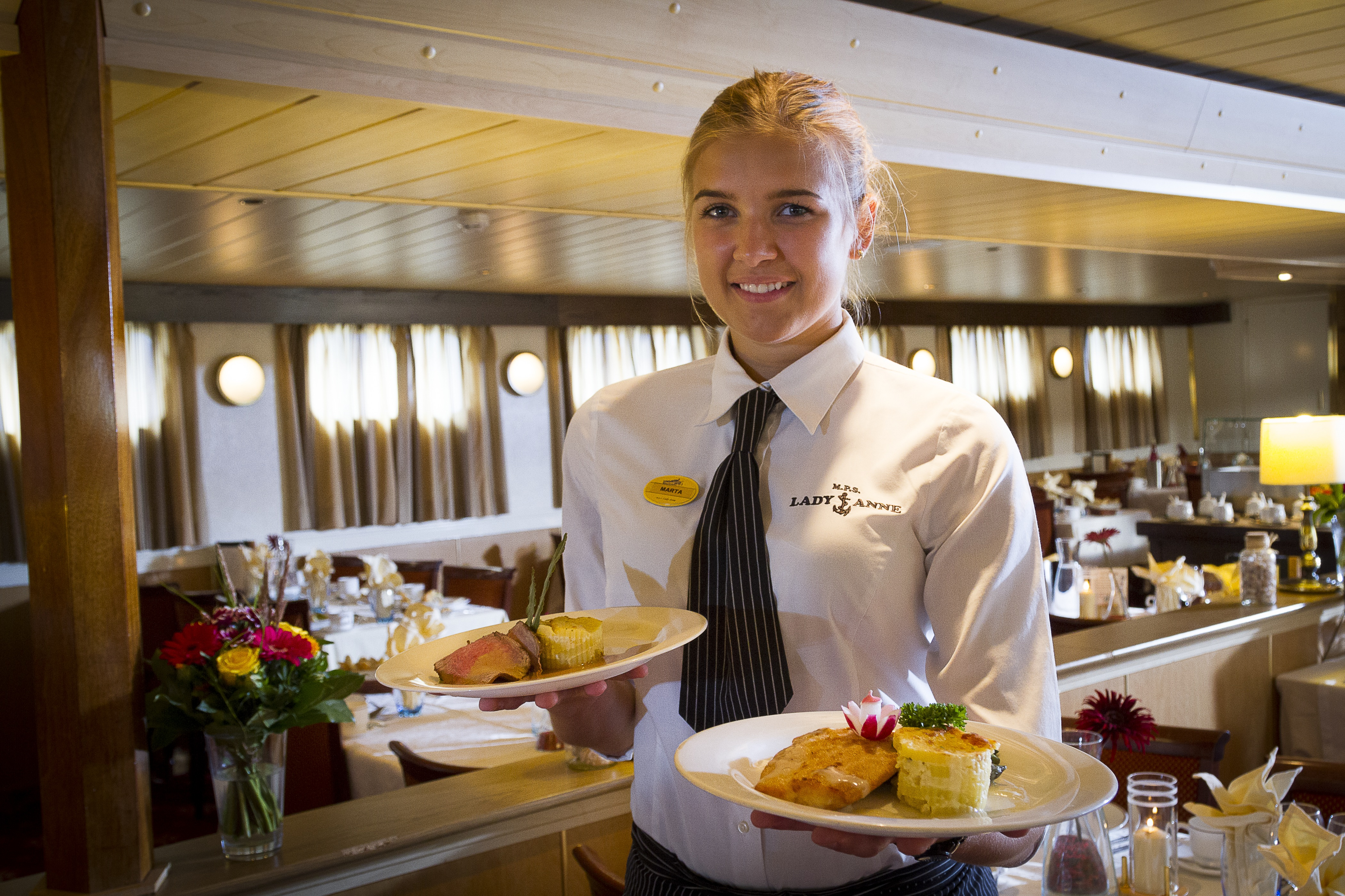 The River Cruise Line MPS Lady Anne Interior Restaurant Waitress.jpg