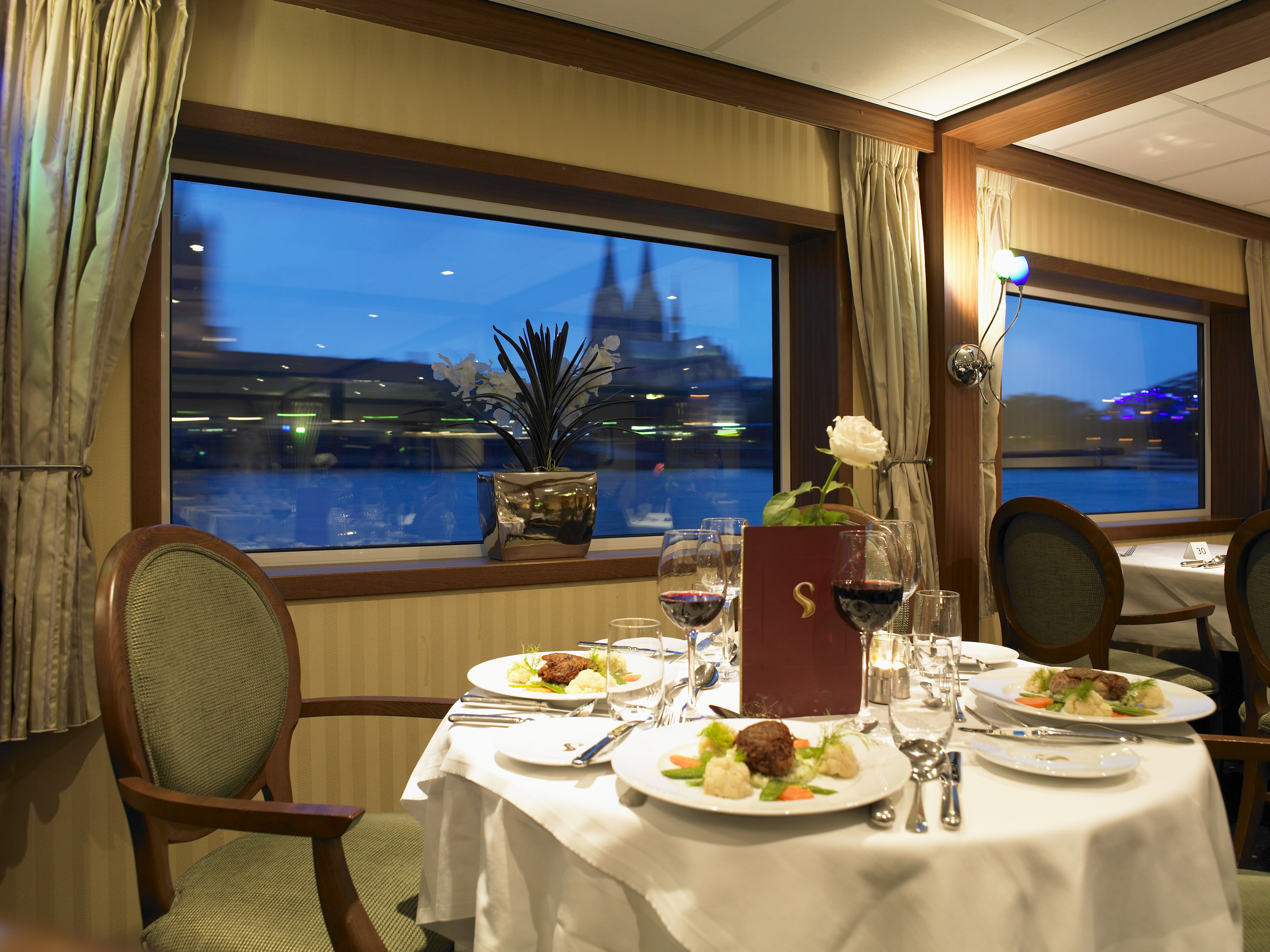 The River Cruise Line MS Serenity Interior Restaurant 1.jpg