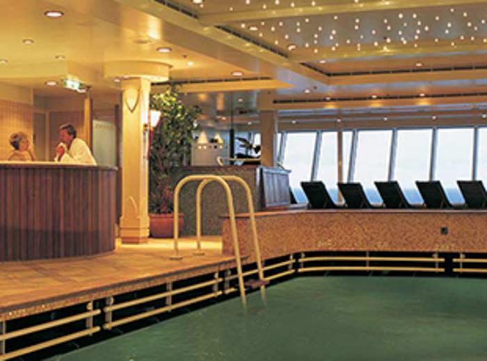 Norwegian Cruise Line Norwegian Dawn Interior Lap Pool and Jacuzzi.jpg