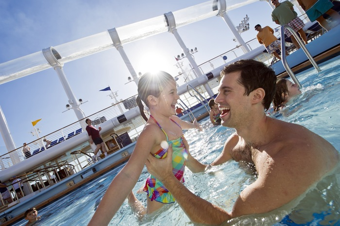 Disney Cruise Line Disney Dream Exterior Father and child in pool.jpg