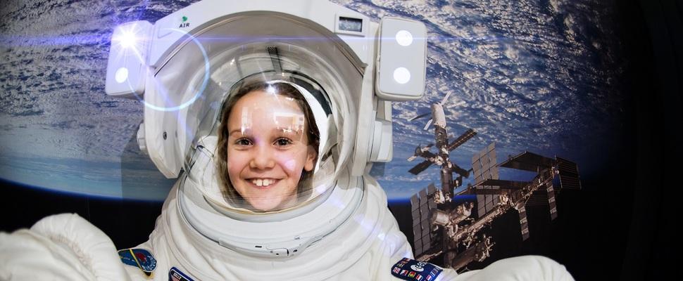 WSC web home 1600 x 760 girl in space gloves.jpg